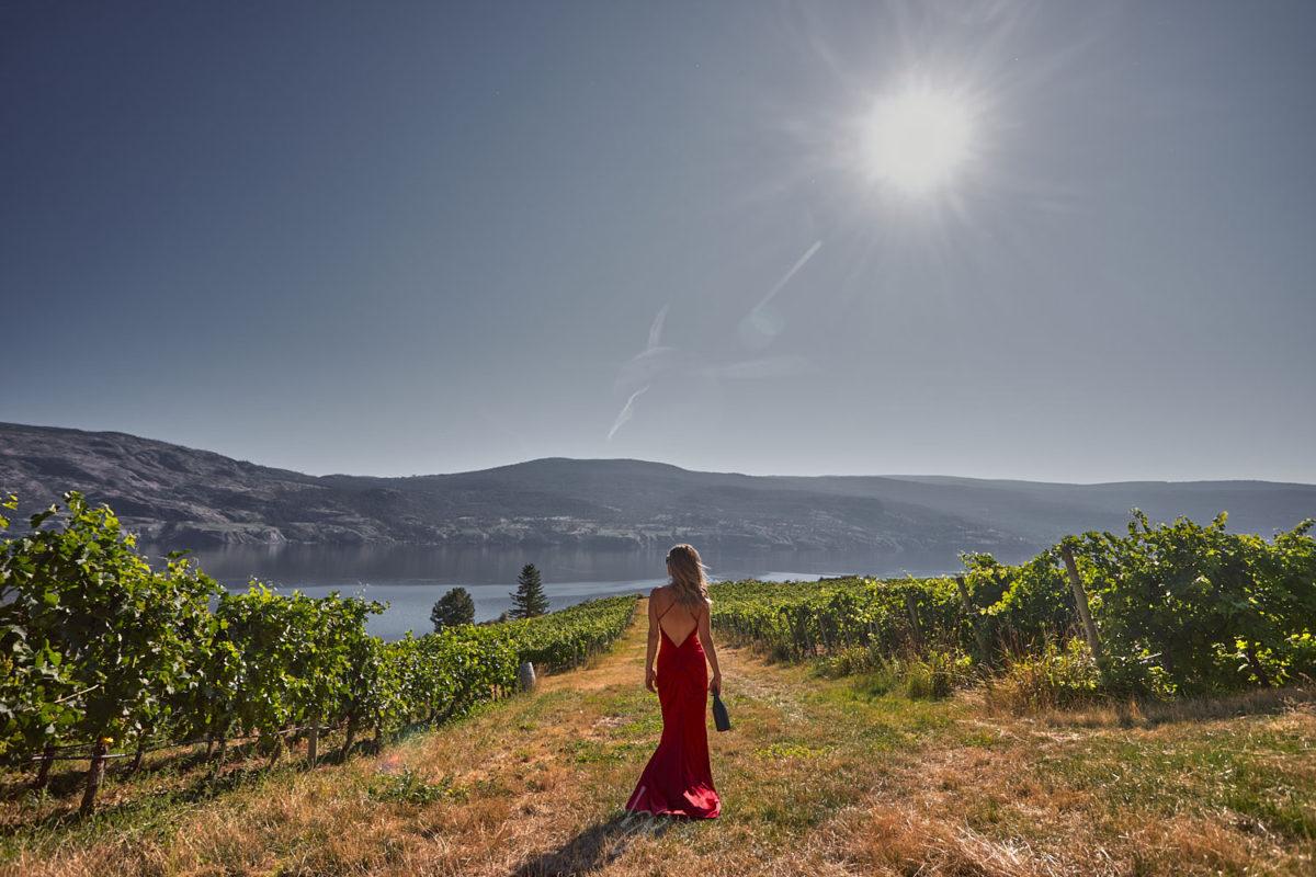 Lady in red dress by kelowna photographer of OAK estate winery