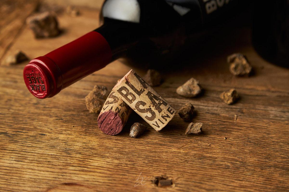 kelowna photographer captures black sage wine cork and wine bottle