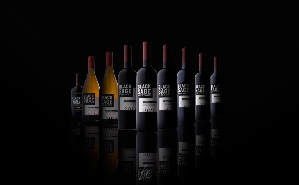 bottle lineup of black sage vineyard wines in studio by kelowna photographer brandon elliot